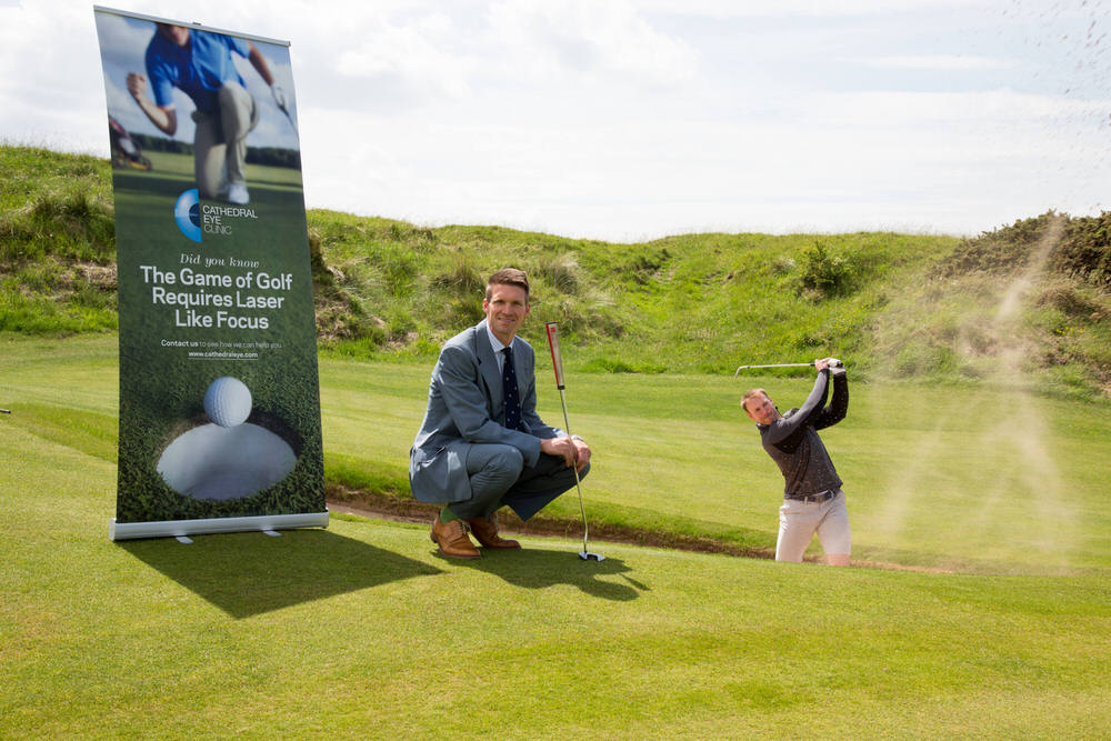 Stephen Ferris, Brand Ambassador for Cathedral Eye, playing from a greenside bunker at the new eighth on the Dunluce Links at Royal Portrush as Cathedral Eye's Andrew Spence looks on Picture:  Golffile | Fran Caffrey
