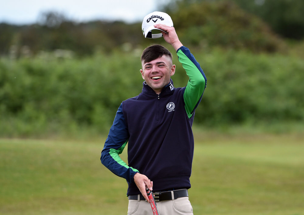 Winner Reece Black (Hilton Templepatrick) raises his cap after holing his final putt on the 18th green in the 2017 East of Ireland Championship at County Louth Golf Club. Picture by  Pat Cashman