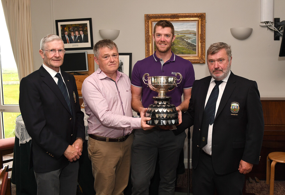 Peter O'Keeffe receives the Kerry Group sponsored Kerry Scratch Cup from sponsor Declan Crowley. Also pictured, Tralee Golf Club Captain John Reen and President Des Fitzgerald.