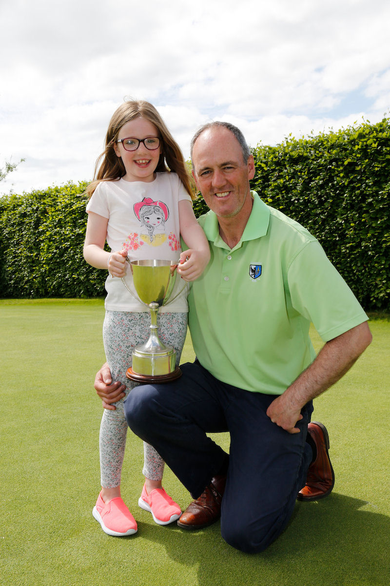 Eddie and his proud daughter Aoife show off the Connacht Mid-Amateur trophy