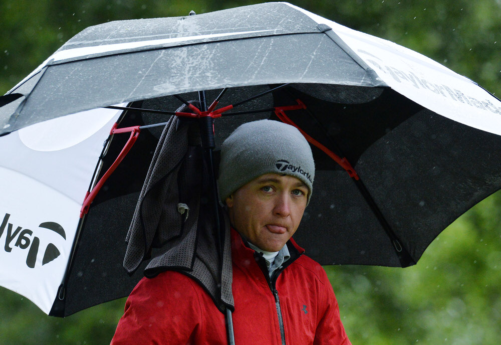 AVIEMORE, SCOTLAND - JUNE 29: Richard James of Wales shelter in the cold and wet conditions at the 5th hole during the first day of the 2017 SSE Scottish Hydro Challenge hosted by MacDonald Hotels and Resorts at Spey Valley Golf Course on June 29, 2017 in Aviemore, Scotland. (Photo by Mark Runnacles/Getty Images)