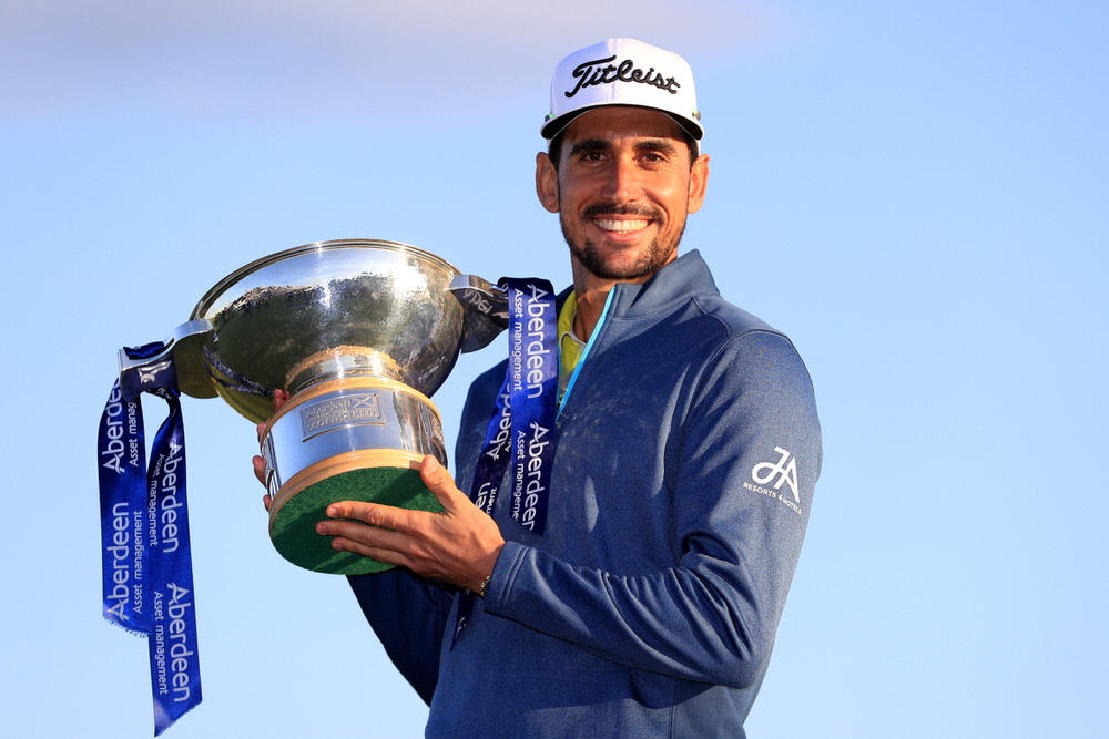 TROON, SCOTLAND - JULY 16:  Rafa Cabrera-Bello of Spain poses with the trophy following his victory on the 1st play off hole during the final round of the AAM Scottish Open at Dundonald Links Golf Course on July 16, 2017 in Troon, Scotland.  (Photo by Andrew Redington/Getty Images)