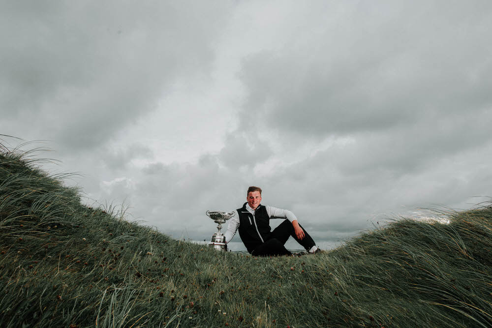 James Sugrue, 2017 South of Ireland champion,takes a moment with the trophy after his 3 and 2 victory over Conor O'Rourke of Naas Golf Club on Sunday evening. Picture © Brian Arthur/Golffile