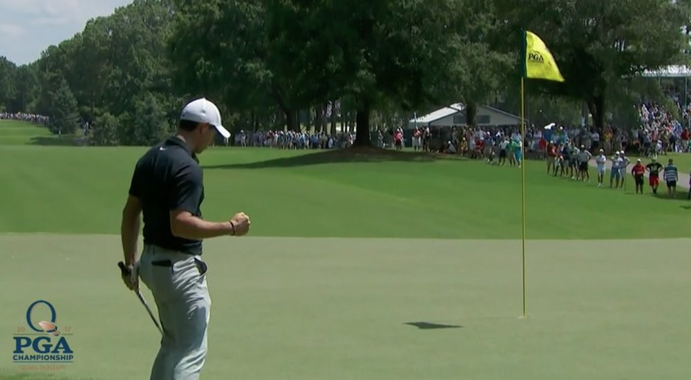 Rory McIlroy chips in at the third.