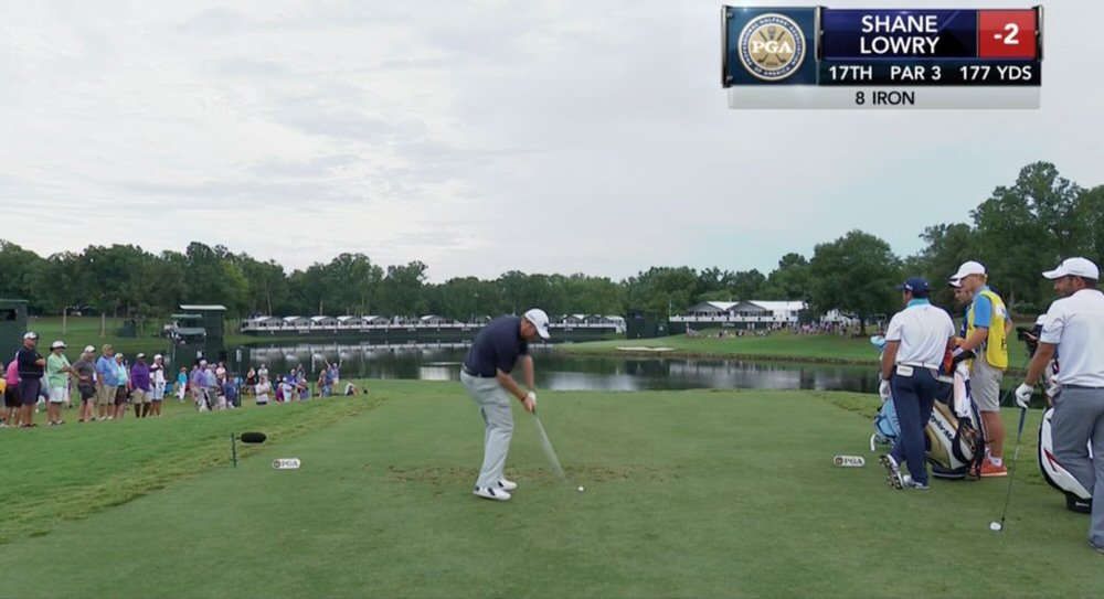 Shane Lowry hits his tee shot at the 17th