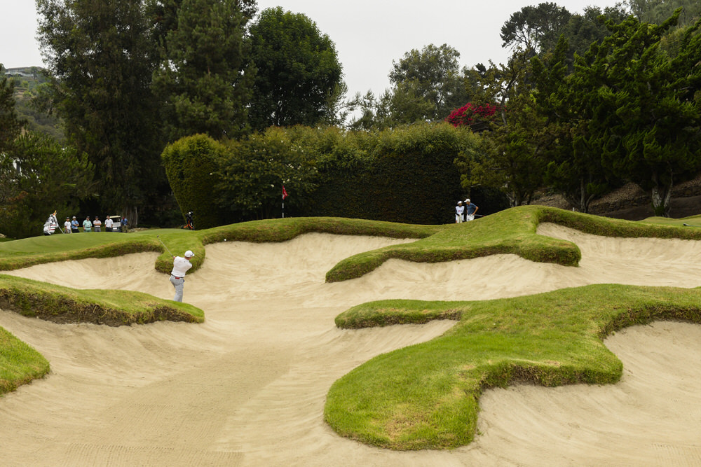 Scott Gregory plays from a green side bunker on the 13th hole during first round of stroke play of the 2017 U.S. Amateur at Bel-Air Country Club in Los Angeles, Calif. on Monday, Aug. 14, 2017.  Copyright USGA/JD Cuban