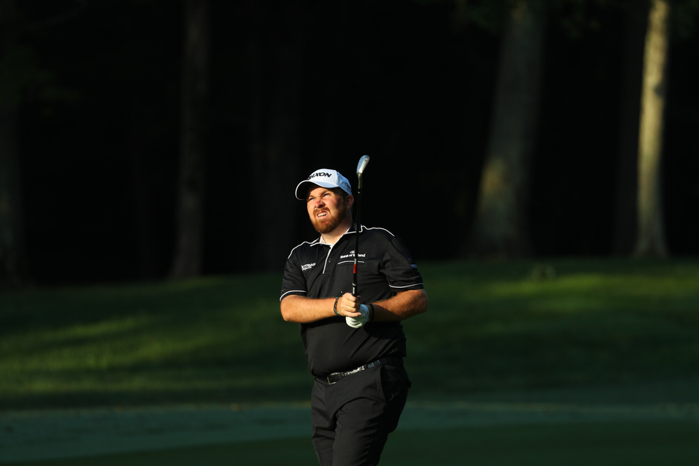 Shane Lowry hits his shot on the 12th hole during round one of the 99th PGA Championship held at Quail Hollow Club. Picture © Scott Halleran/PGA of America