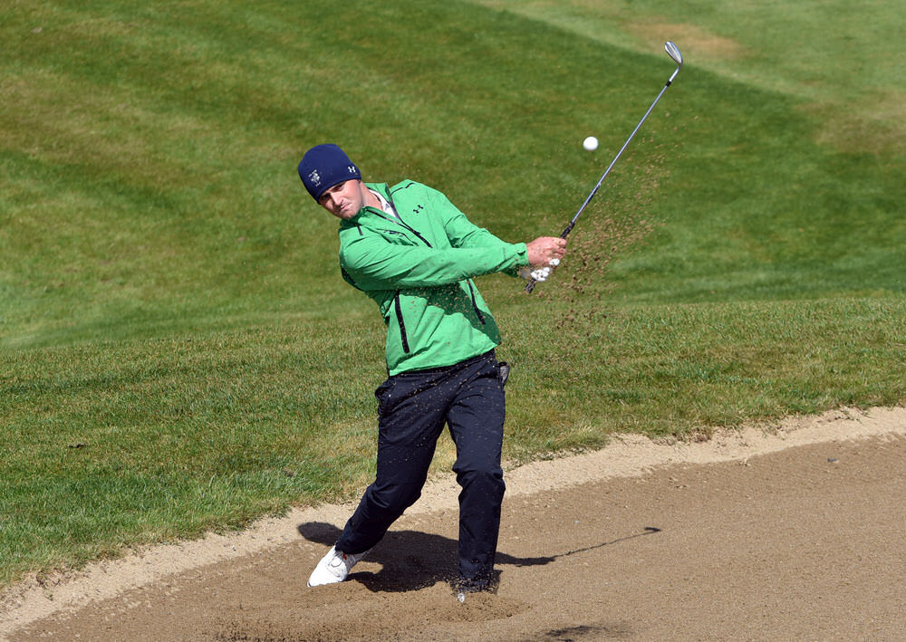 Conor O'Rourke (GUI) bunkered at the 11th during the foursomes at the Corrib Oil sponsored Carey Cup matches at Galway Bay Golf Resort. Picture by Pat Cashman