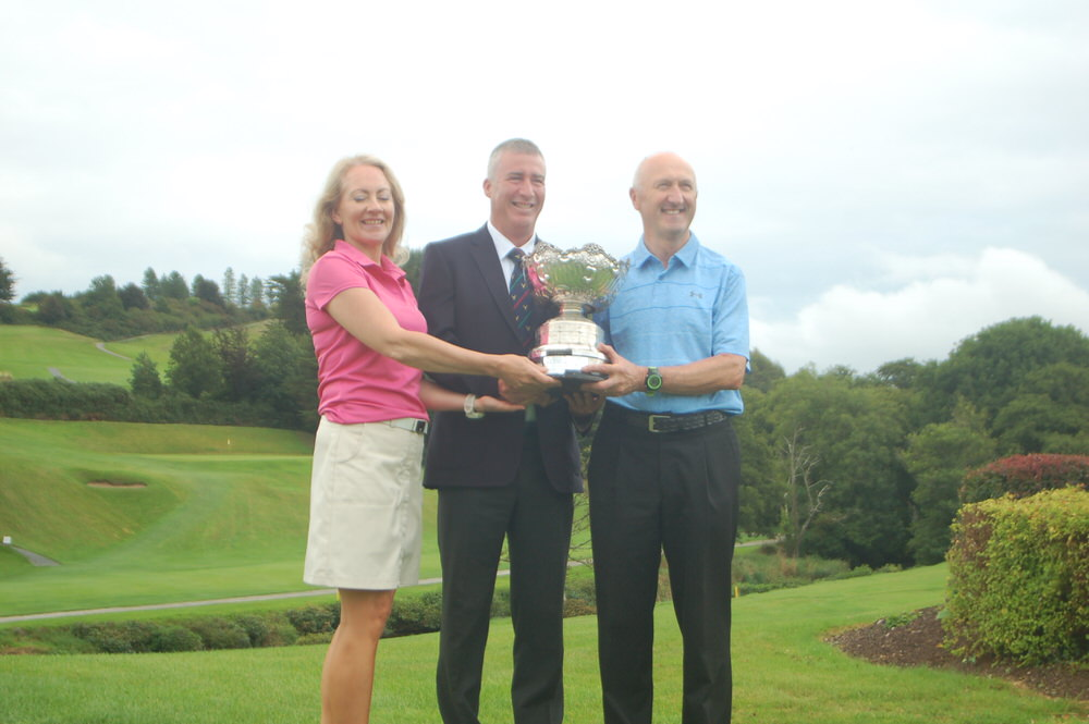 Skibbereen's Rhona O'Donoghue and John McNamara and pictured with Muskerry Golf Club captain, Jim Hornibrook following their win in the Munster Mixed Foursomes Interclub Cup