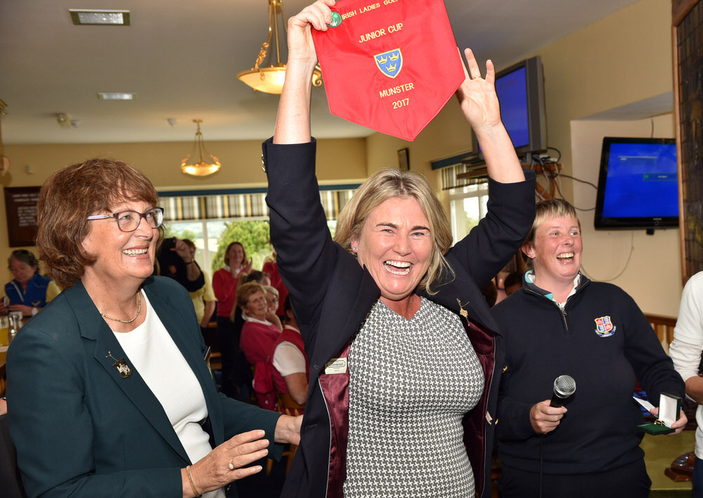 Ailish Dilger (Lady Captain, Limerick Golf Club) accepts the Junior Cup pennant (Munster section) watched by Frances Hough (Chairperson, Munster District, ILGU) after their victory in the 2017 AIG Ladies Cups and Shields (Munster) Finals at Cahir Park Golf Club (02/09/2017) . Picture by  Pat Cashman
