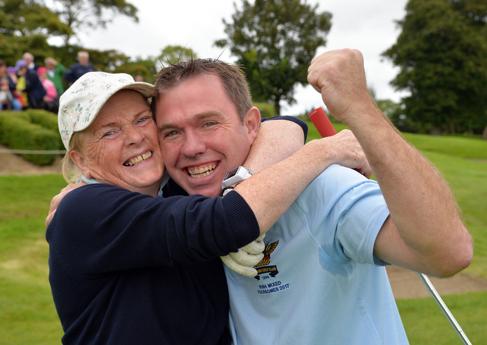 Cait Cooney and Colm Cassidy (Tullamore) celebrate their victory on the 16th green to clinch the 2017 I Need Spain Irish Mixed Foursomes All Ireland Finals at Castlebar Golf Club (09/09/2017). Picture by  Pat Cashman
