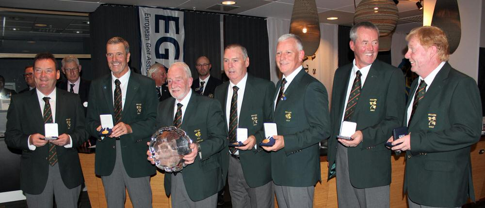 Irish captain Seanie O'Leary with the trophy and his gold medal winning team