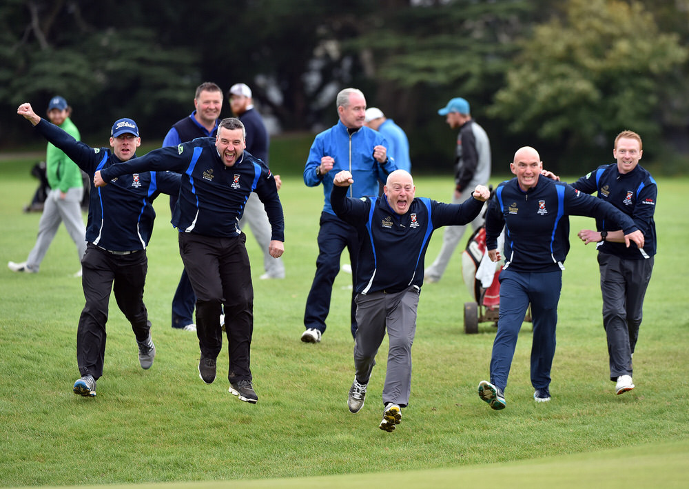 Castlebar's Dave Walsh leads the charge at the 18th green after victory in the final of the AIG Jimmy Bruen at Carton House (23/09/2017). Picture by Pat Cashman