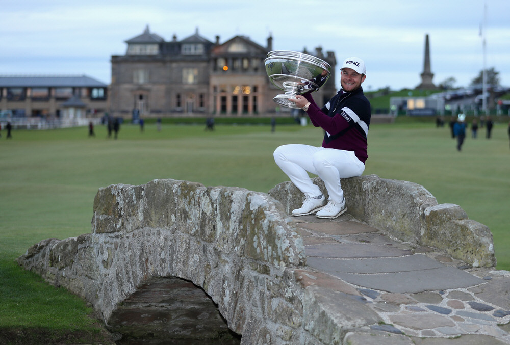 Tyrrell Hatton of England celebrates victory with the trophy on the Swilken Bridge following the final round of the 2017 Alfred Dunhill Championship at The Old Course on October 8, 2017 in St Andrews, Scotland. Photo by Richard Heathcote/Getty Images