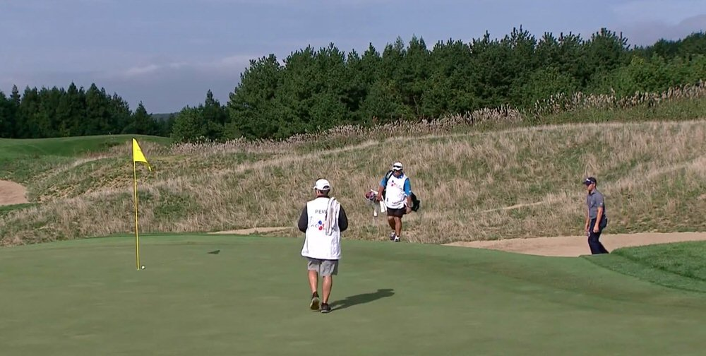 Justin Thomas making his first chip in of the day at his sixth hole, the 15th