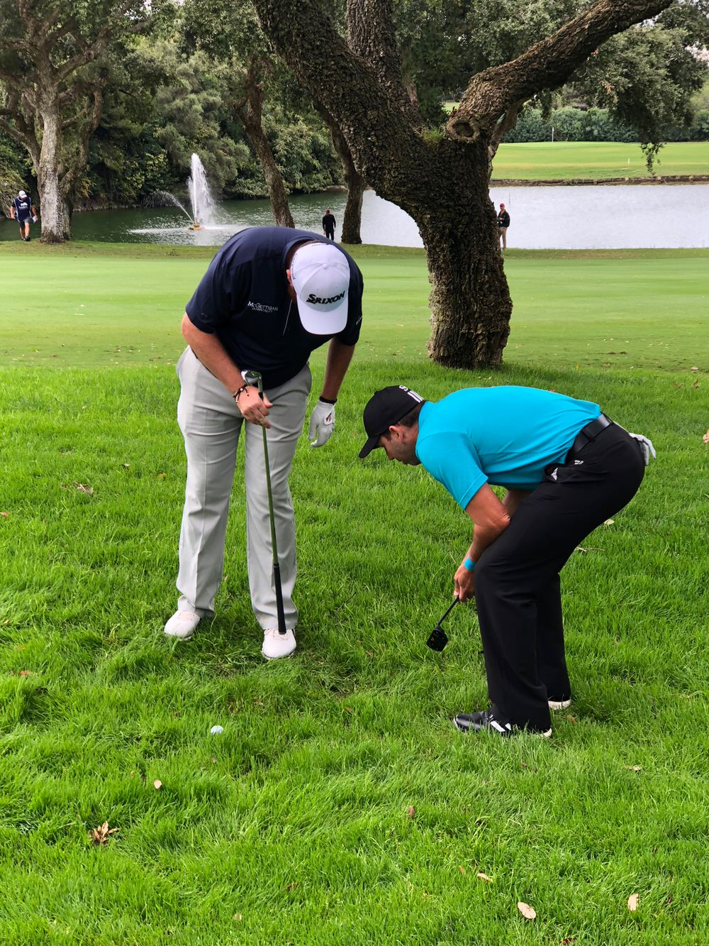 Shane Lowry asks Sergio Garcia to confirm he can take relief from casual water on the 18th hole at a soggy Valderrama. Garcia signed for a five under par round of 66 while Lowry had to settle for a one over par 72. Picture courtesy Denis Kirwan/Meridian Media