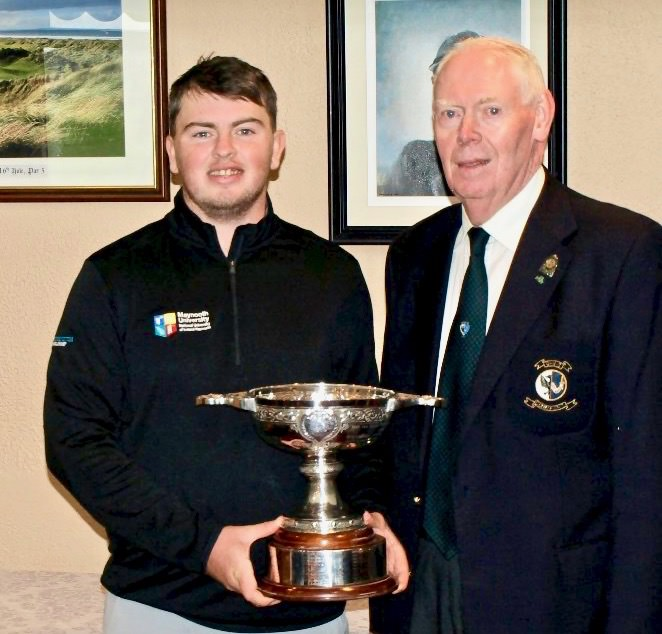 Jim McGovern (Chairman Connacht Golf) presents the Irish Intervarsity Championship men's trophy to Maynooth University's Caolan Rafferty. Picture ©  Harrington Scholars‏ @MU_Golf