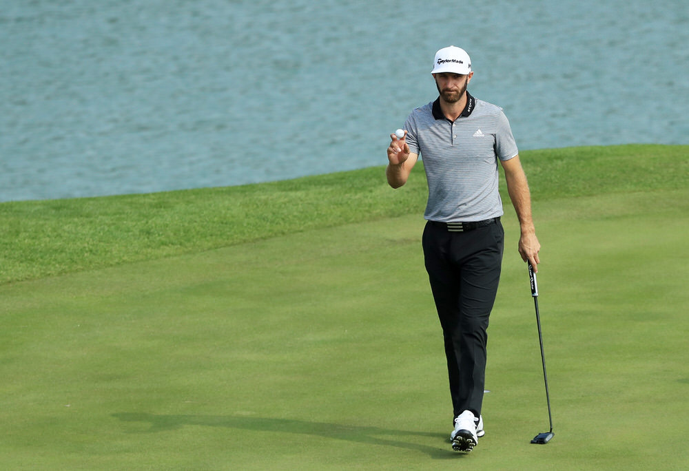 Dustin Johnson acknowledges the applause of the gallery en route to a 63 in the second round of the WGC - HSBC Champions at Sheshan International Golf Club. Photo by Andrew Redington/Getty Images