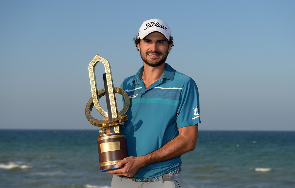 Clement Sordet of France poses with the Grand Final Trophy during Day Four of the NBO Golf Classic Grand Final at Al Mouj Golf in Muscat, Oman. Photo by Tom Dulat/Getty Images