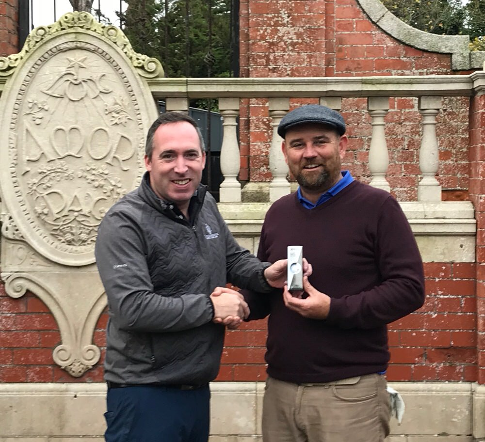 Portmarnock Hotel & Golf Links professional Conor Russell presents Gary Murphy with a sleeve of balls, TaylorMade, presumably