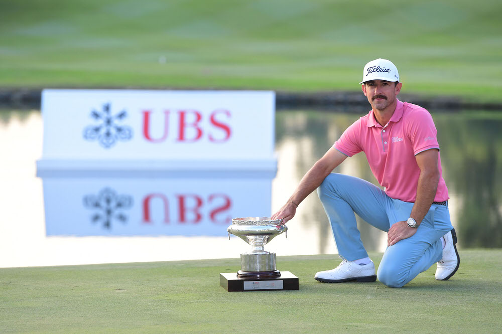 Wade Ormsby of Australia poses with the trophy after winning the UBS Hong Kong Open at The Hong Kong Golf Club. Photo by Arep Kulal/Getty Images