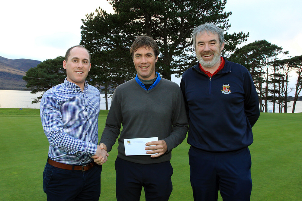 Cian McNamara presenting first prize to Tim Rice after the Munster PGA Winter Series event at Killarney. Also pictured, David Keating from Killarney Golf & Fishing Club. Picture: Niall O'Shea
