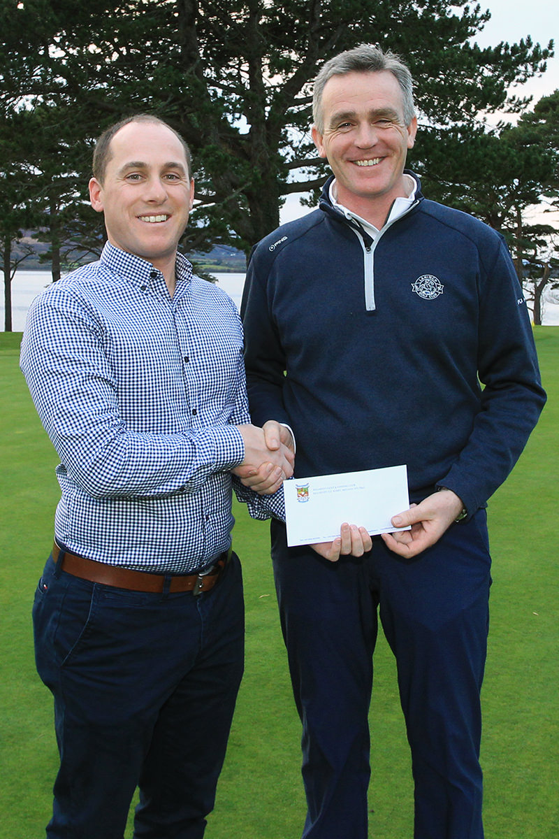 Lahinch's Donal McSweeney receives his prize from Cian McNamara at the Munster PGA Winter Series event in Killarney. Picture: Niall O'Shea