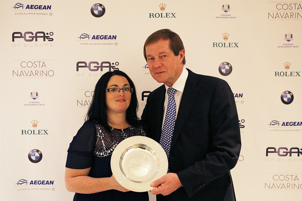 PGAs of Europe Honorary President,George O'Grady CBE, presents Catherine with Liam's award