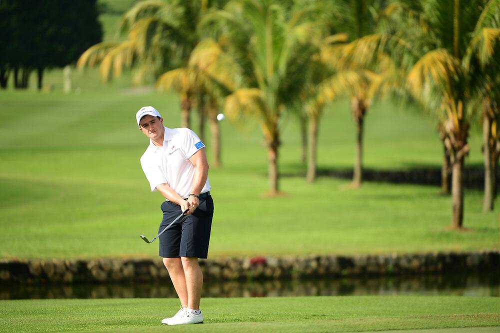Short game. Paul Dunne chipping during a practice round for this week's EurAsia Cup at Glenmarie Golf and Country Club in Kuala Lumpur. Picture: Asian Tour