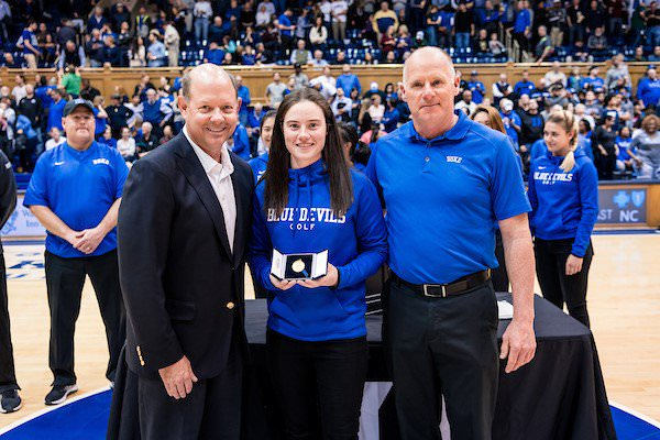 Pictured with the USGA's Mike Davis and Duke women's golf head coach Dan Brooks,  Leona Maguire shows off the 2017 Mark H. McCormack Medal, her third in a row.
