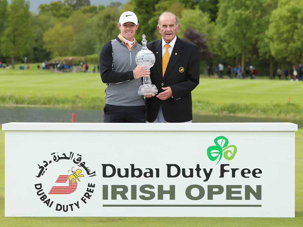Rory McIlroy of Northern Ireland receives the Dubai Duty Free Irish Open trophy from Colm McLoughlin, the Executive Vice Chairman of Dubai Duty Free, after winning the tournament hosted by the Rory Foundation at The K Club on May 22, 2016 in Straffan. (Photo by Andrew Redington/Getty Images)
