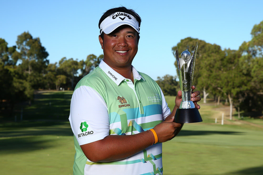 Thailand's Kiradech Aphibarnrat holds the trophy following his win over Australia's James Nitties in the ISPS HANDA World Super 6 Perth at Lake Karrinyup Country Club. Photo by Paul Kane/Getty Images