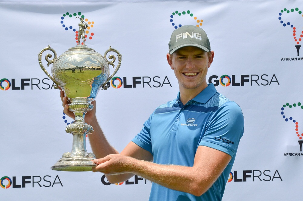 Pretoria Golf Club's James du Preez raises the African Amateur Stroke Play trophy following his three-shot win at Glendower Golf Club.  Credit Ernest Blignault
