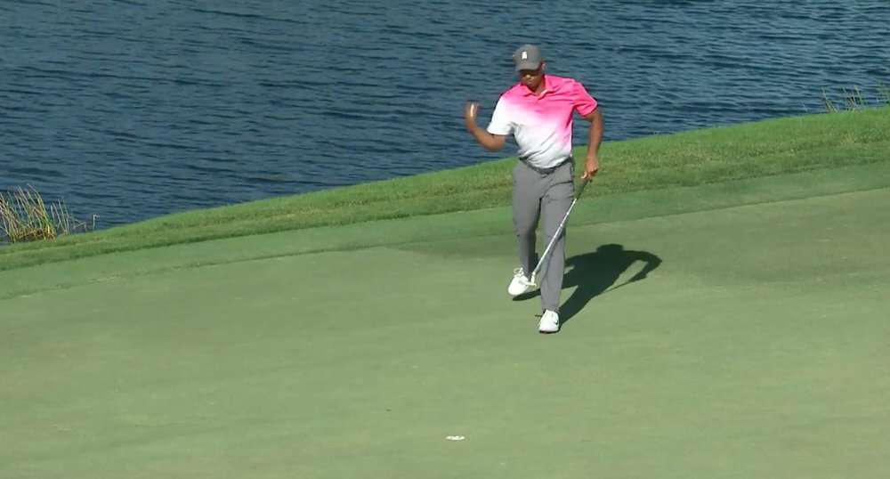 Tiger fist pumps after his par save on the 11th