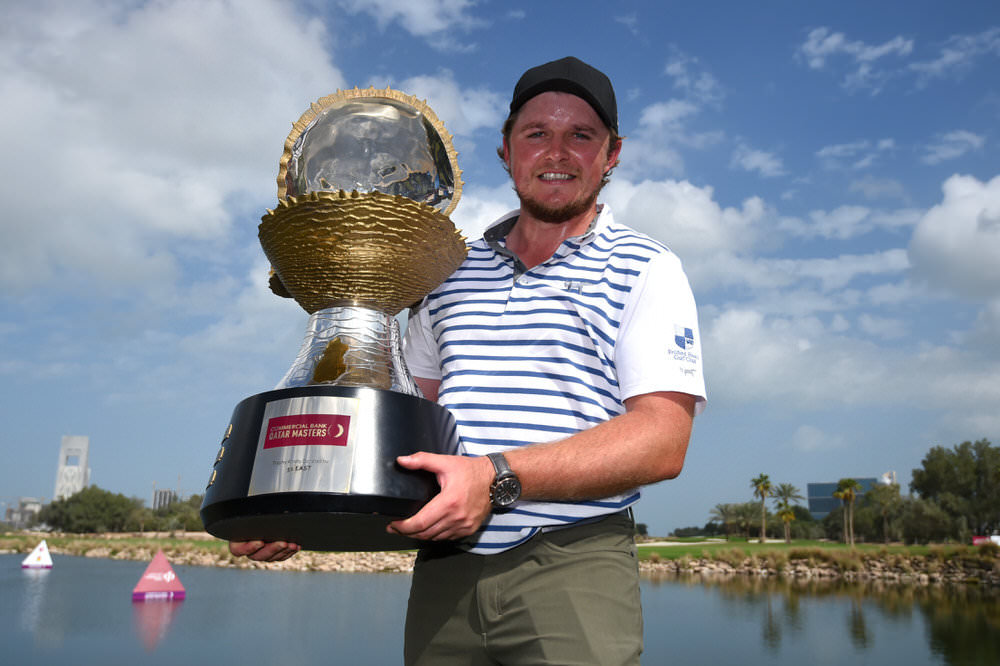 England's Eddie Pepperell poses with the trophy following his victory in the Commercial Bank Qatar Masters at Doha Golf Club. Photo by Tom Dulat/Getty Images