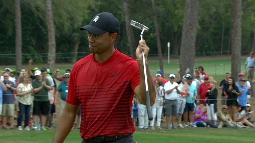 Tiger Woods salutes the crowd after making his 44 footer at the 17th
