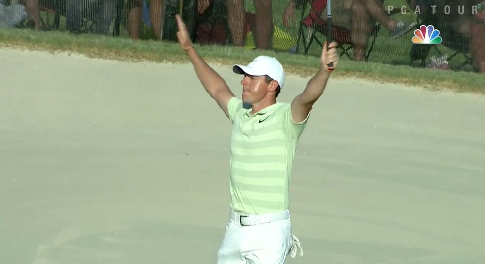 Rory McIlroy raises his arms aloft after making a 25 footer for a closing birdie for a three-shot win in the Arnold Palmer Invitational at Bay Hill.
