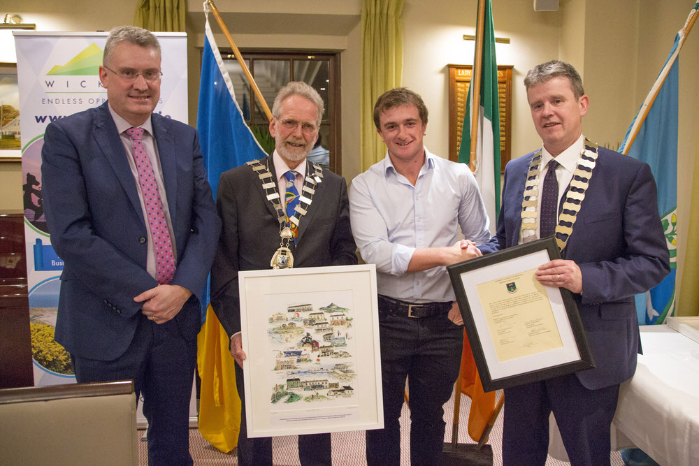 CEO of Wicklow County Council Frank Curran, Cllr Derek Mitchell and Cathaoirleach Edward Timmins make a presentation to golfer Paul Dunne at a Civic Reception held in his honour at Greystones Golf Club last month.