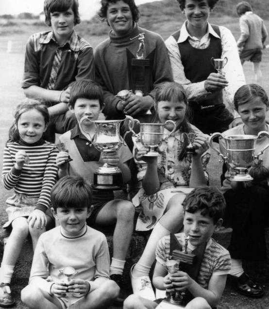 Jody (front left) with Suzie (in stripes) just behind him, showing off their trophies at Laytown and Bettystown
