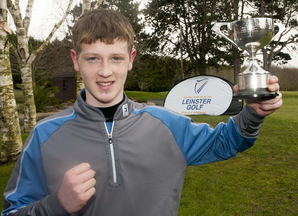 Naas' Jamie Butler shows off the Leinster U16 Boys trophy.Photo: Ronan Quinlan