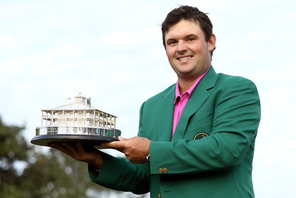 Patrick Reed celebrates with the trophy during the green jacket ceremony after winning the 2018 Masters Tournament at Augusta National Golf Club on April 8, 2018. Photo by Jamie Squire/Getty Images