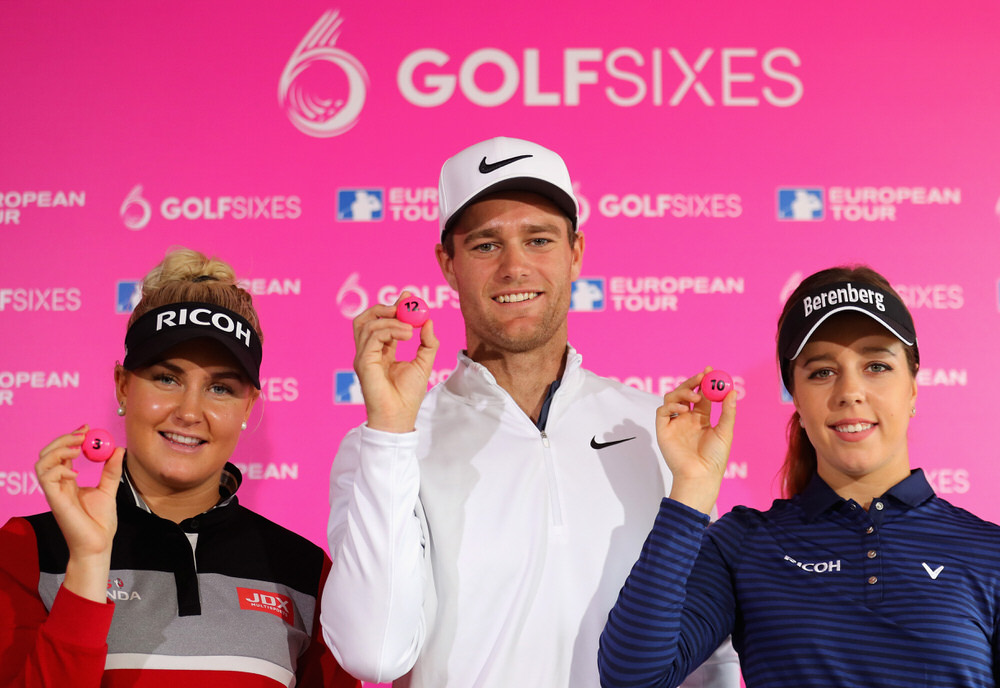 ST ALBANS, ENGLAND - APRIL 12:  Charley Hull of England, Lucas Bjerregaard of Denmark and Georgia Hall of England pose for a photo after selecting for the draw during the GolfSixes Media Day at The Centurion Club on April 12, 2018 in St Albans, England.  (Photo by Warren Little/Getty Images)