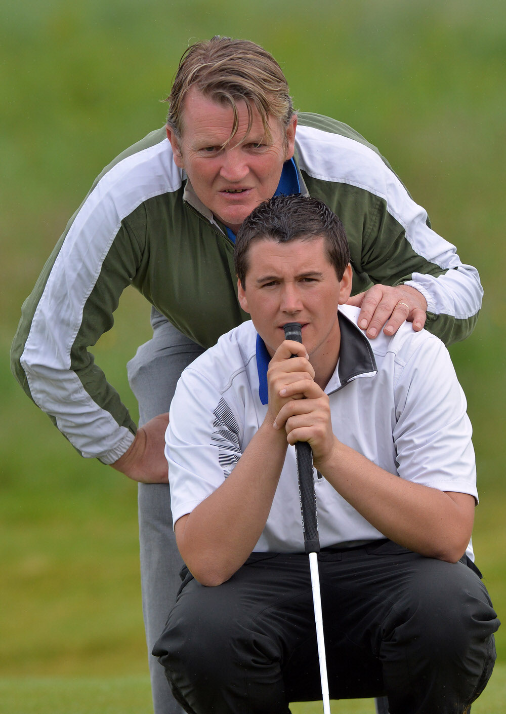 Colm Campbell (Warrenpoint) and his caddy Paddy Gribben lining up a putt on the 9th green in the final round of the  2014 East of Ireland Championship  at County Louth Golf Club, where he edged out Paul Dunne by two strokes to win the title. Picture by  Pat Cashman
