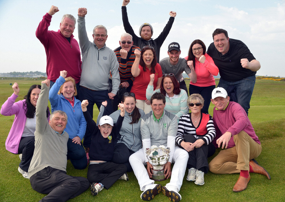 Winner Colm Campbell (Warrenpoint) pictured with the 2016 Flogas Irish Amateur Open Championship trophy and Warrenpoint supporters after his victory at The Royal Dublin Golf Club (08/05/2016). Picture by  Pat Cashman