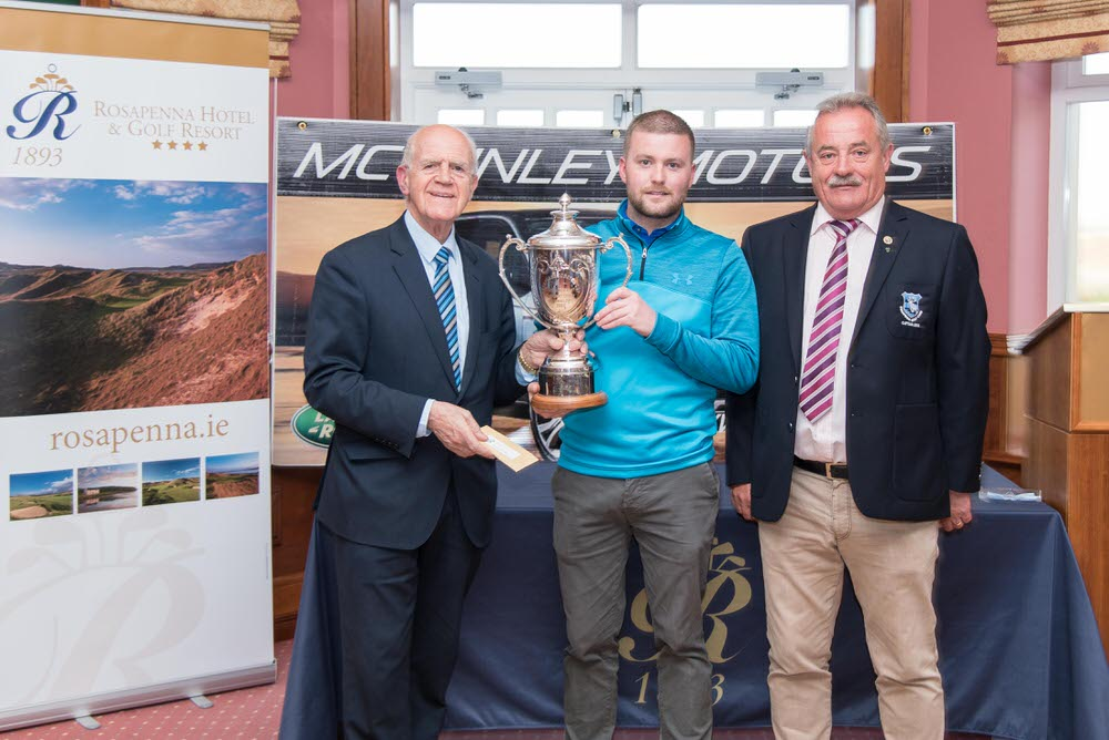 Noel McGinley of McGinley Motors, Letterkenny (left) and Rosapenna Captain Liam Breen (right) present the Rosapenna Senior Scratch Cup to Dungannon's Dwayne Mallon. Picture: Martin Fleming