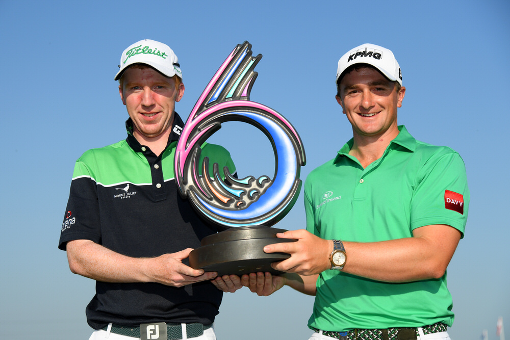 Paul Dunne and Gavin Moynihan (L) of Ireland celebrate victory in the GolfSixes at The Centurion Club on May 6, 2018 in St Albans, England. Photo by Ross Kinnaird/Getty Images