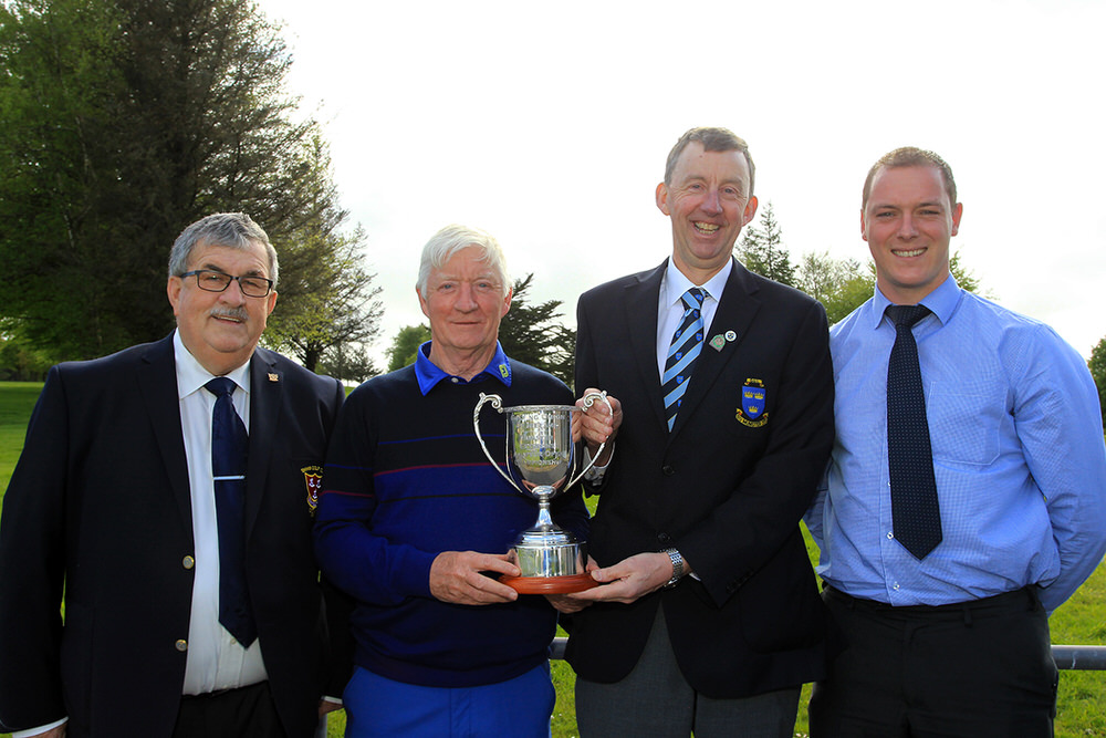Maurice Kelly (Naas) receiving the Munster Veterans trophy