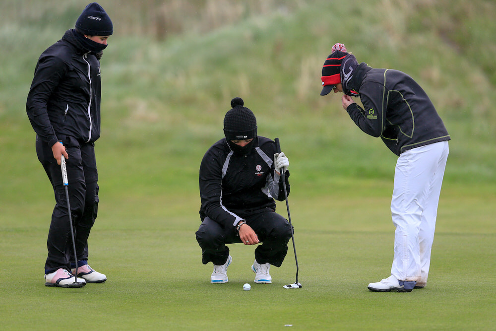 Alessia Nobilio (ITA), Sophie Lamb (ENG), Jessica Ross (Clandeboye) struggle in the wind during the first round of the Irish Women's Open Strokeplay Championship at Co Louth Golf Club, Baltray. Picture: Golffile | Fran Caffrey
