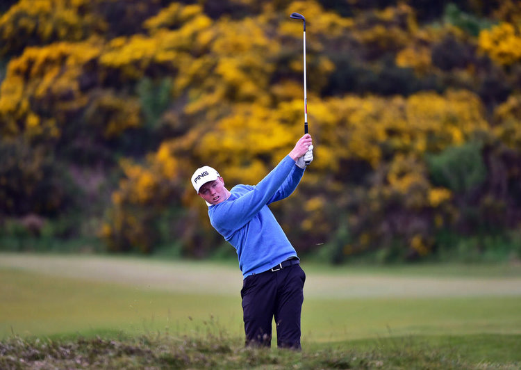 Robin Dawson (Tramore) pitching to the 16th green during day three of the Flogas Irish Amateur Open Championship at Royal County Down Golf Club. Picture by  Pat Cashman