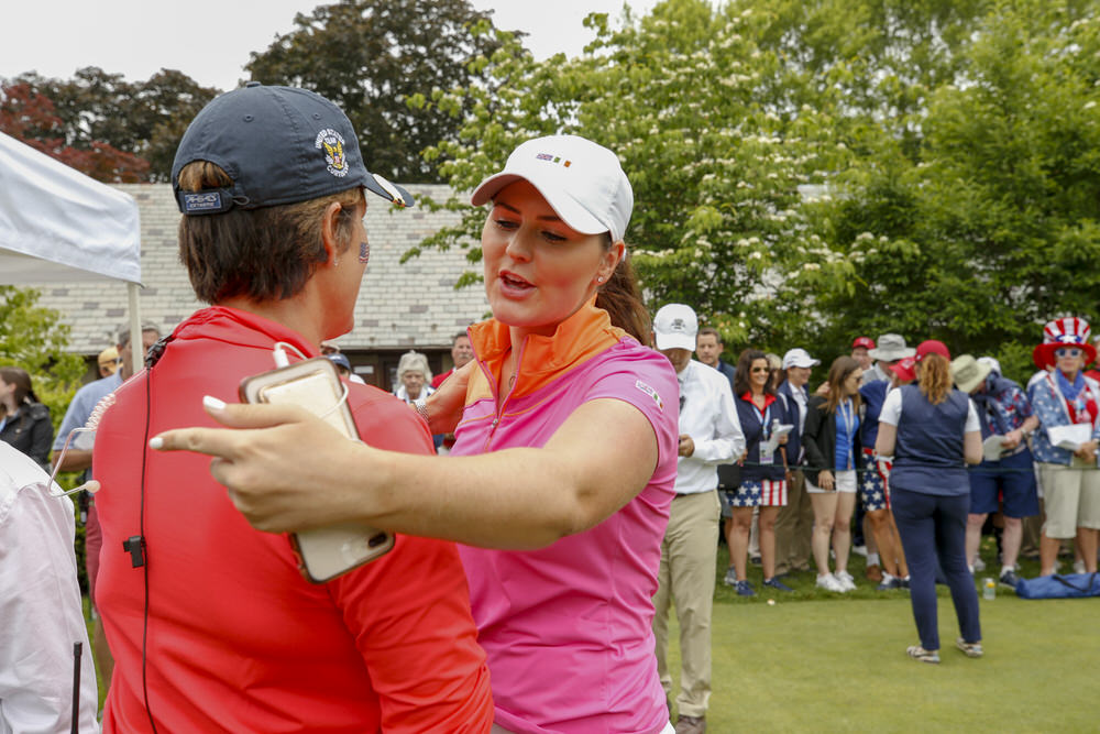 GB&I player Olivia Mehaffey hugs USA team Captain Virginia Derby Grimes before the start of the singles matches of the 2018 Curtis Cup at Quaker Ridge Golf Club in Scarsdale, N.Y. on Sunday, June 10, 2018.  (Copyright USGA/Steven Gibbons)
